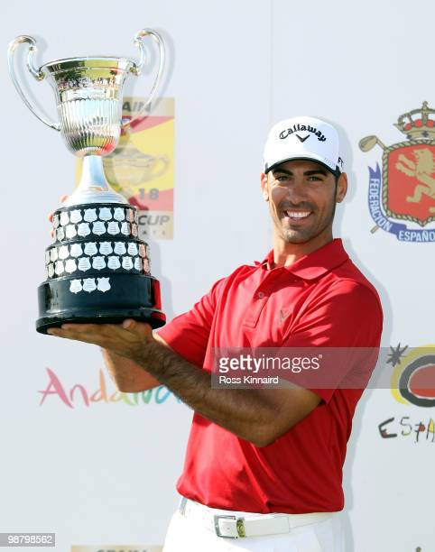 Alvaro Quiros of Spain with the winners trophy after the final round of the Open de Espana at the Real Club de Golf de Seville on May 2 2010 in...