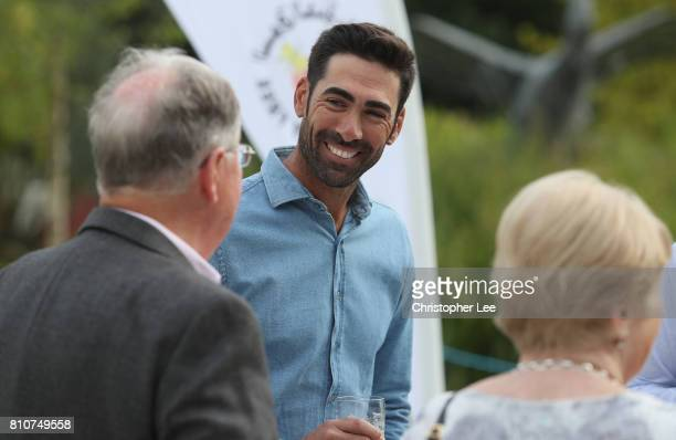 Alvaro Quiros talks to other guest during the Arabian Nights party after Day Two of the Dubai Duty Free Irish Open at Portstewart Golf Club on July 7...