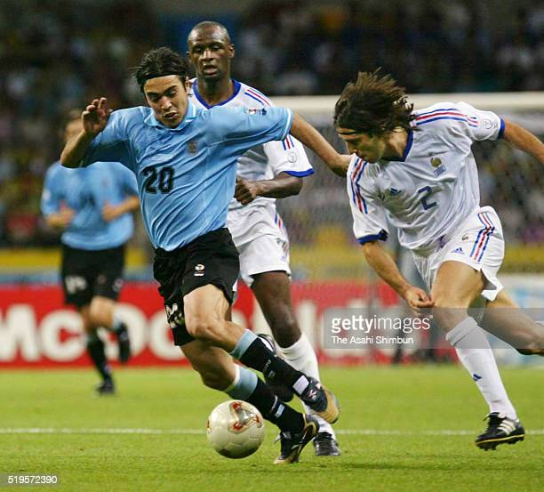 Alvaro Recoba of Uruguay and Vincent Candela of France compete for the ball during the FIFA World Cup Korea/Japan Group A match between France and...