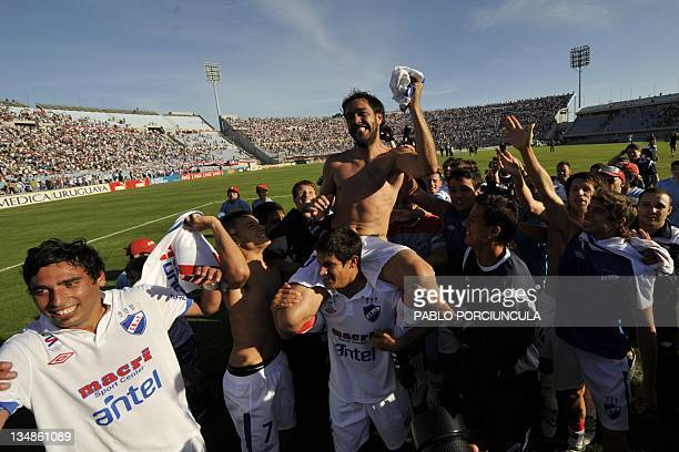 Alvaro Recoba of Uruguay's Nacional is carried on shoulders by his teammates after winning the Apertura tournament at the Centenario stadium in...