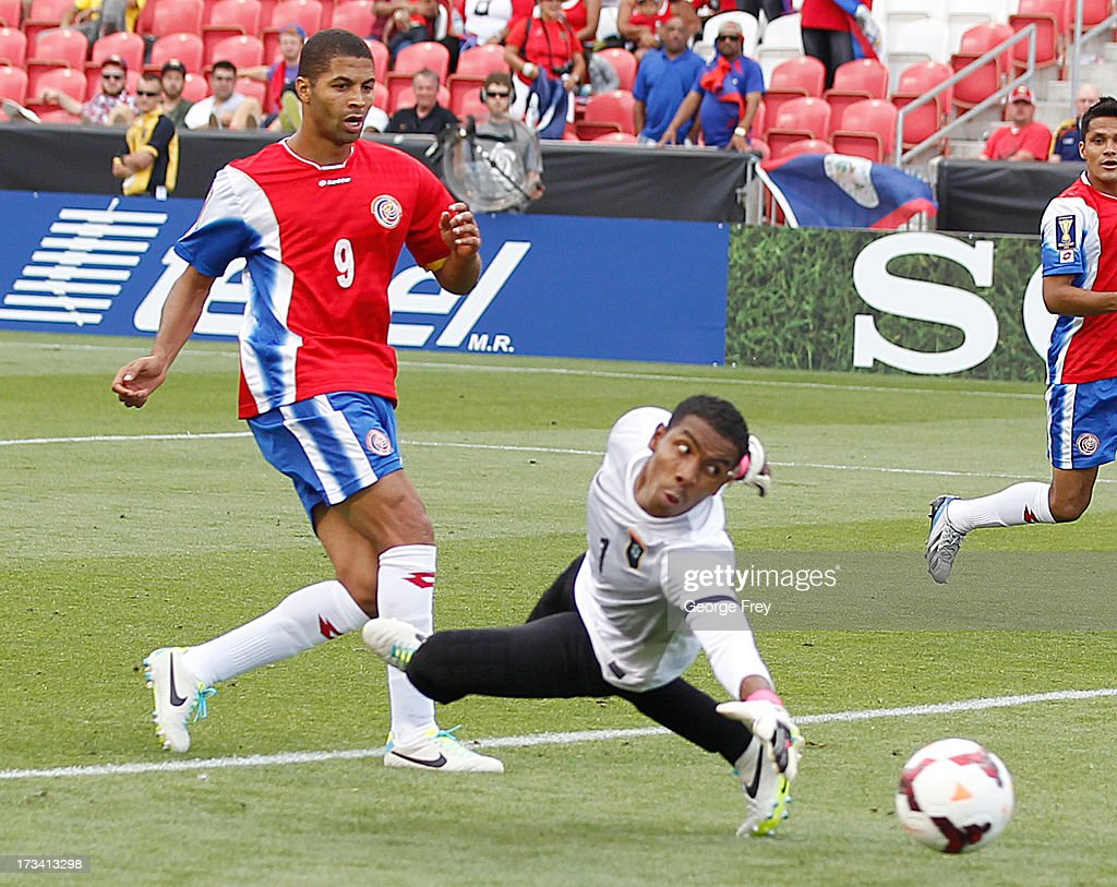 <a gi-track='captionPersonalityLinkClicked' href=/galleries/search?phrase=Alvaro+Saborio&family=editorial&specificpeople=554699 ng-click='$event.stopPropagation()'>Alvaro Saborio</a> #9 of Costa Rica misses a shot on goal as goalie Leonel Moreira #1 of Belize looks back during the second half of a CONCACAF Gold Cup match July 13, 2013 at Rio Tinto Stadium in Sandy, Utah. Costa Rica defeated Belize 1-0.