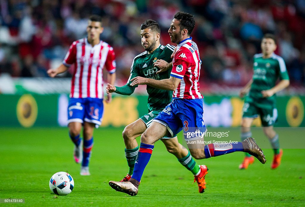 Alvaro Vadillo of Real Betis Balompie duels for the ball with Alex Menendez of Real Sporting de Gijon during the Copa del Rey Round of 32 match between Real Sporting de Gijon and Real Betis Balompie at Estadio El Molinon on December 15, 2015 in Gijon, Spain.