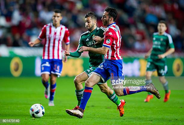 Alvaro Vadillo of Real Betis Balompie duels for the ball with Alex Menendez of Real Sporting de Gijon during the Copa del Rey Round of 32 match...