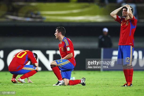 Alvaro Vazquez Hugo Mallo and Carles Planas of Spain react after the FIFA U20 World Cup 2011 quarter final match between Brazil and Spain at Estadio...