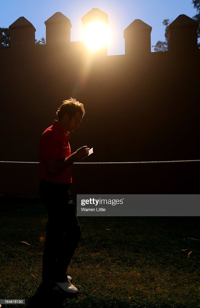 Alvaro Velasco of Spain signs his card as he finishes his first round of the Trophee du Hassan II Golf at Golf du Palais Royal on March 28, 2013 in Agadir, Morocco.