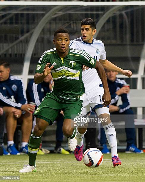 Alvas Powell of the Portland Timbers runs with the ball after getting past Matas Laba of the Vancouver Whitecaps FC in MLS action on March 28 2015 at...