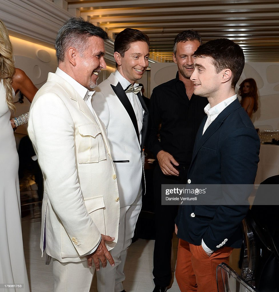 Alviero Martini, Gianluca Mach and <a gi-track='captionPersonalityLinkClicked' href=/galleries/search?phrase=Daniel+Radcliffe&family=editorial&specificpeople=204144 ng-click='$event.stopPropagation()'>Daniel Radcliffe</a> attend the 'Kill Your Darlings' Party during the 70th Venice International Film Festival at the Centurion Palace Hotel on September 2, 2013 in Venice, Italy.
