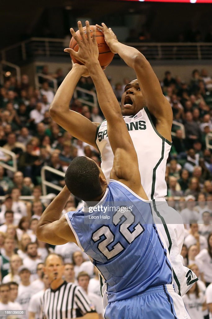 Alvin Ellis III #3 of the Michigan State Spartans drives the ball over Meiko Lyles #22 of the Columbia Lions during the second half og the game at Breslin Center on November 15, 2013 in East Lansing, Michigan. Michigan State defeated Columbia 62-53.