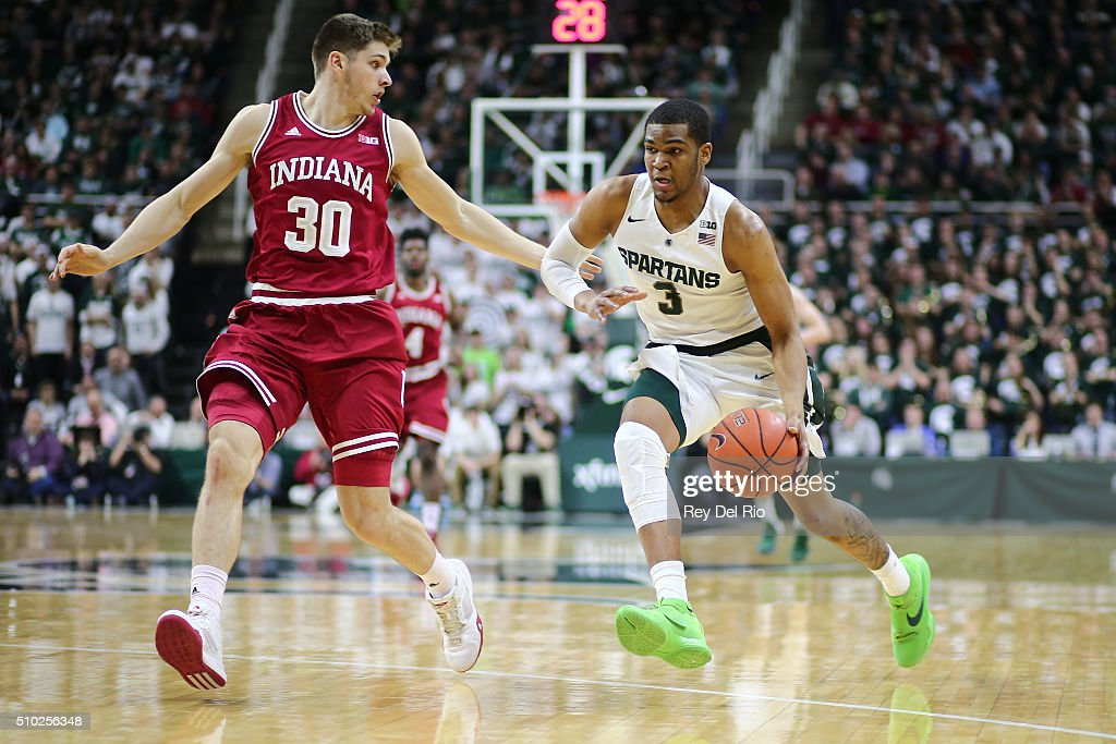 <a gi-track='captionPersonalityLinkClicked' href=/galleries/search?phrase=Alvin+Ellis+III&family=editorial&specificpeople=11623526 ng-click='$event.stopPropagation()'>Alvin Ellis III</a> #3 of the Michigan State Spartans drives to the basket against Collin Hartman #30 of the Indiana Hoosiers in the second half at the Breslin Center on February 14, 2016 in East Lansing, Michigan.