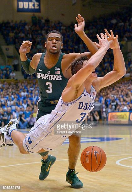Alvin Ellis III of the Michigan State Spartans fouls Grayson Allen of the Duke Blue Devils during the game at Cameron Indoor Stadium on November 29...