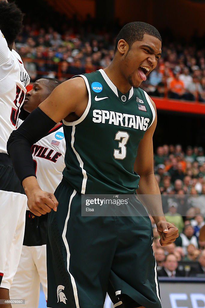 Alvin Ellis III of the Michigan State Spartans reacts after a basket in the first half of the game against the Louisville Cardinals during the East...