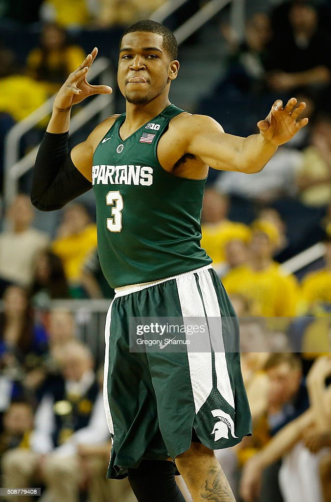 <a gi-track='captionPersonalityLinkClicked' href=/galleries/search?phrase=Alvin+Ellis+III&family=editorial&specificpeople=11623526 ng-click='$event.stopPropagation()'>Alvin Ellis III</a> #3 of the Michigan State Spartans reacts after a second half three pointer while playing the Michigan Wolverines at Crisler Center on January 6, 2016 in Ann Arbor, Michigan. Michigan State won the game 89-73.