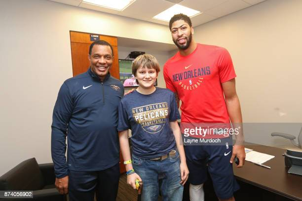 Alvin Gentry and Anthony Davis of the New Orleans Pelicans participates in a game day experience with Ochsner Health System Hero of the Game Allen...