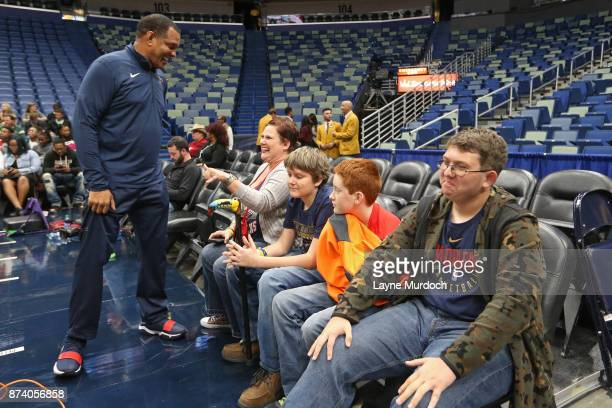 Alvin Gentry of the New Orleans Pelicans participates in a game day experience with Ochsner Health System Hero of the Game Allen Dedon before the...
