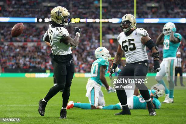 Alvin Kamara of New Orleans Saints celebrates scoring a touchdown during the NFL International Series match between New Orleans Saints and Miami...