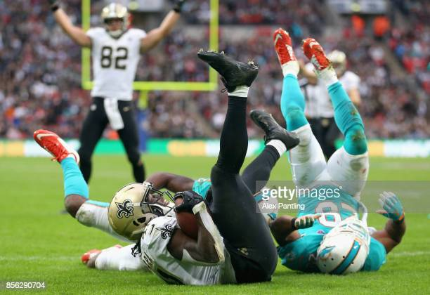 Alvin Kamara of New Orleans Saints scores a touchdown during the NFL International Series match between New Orleans Saints and Miami Dolphins at...