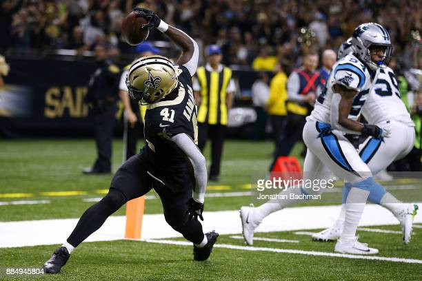 Alvin Kamara of the New Orleans Saints celebrates a touchdown during the first half of a game against the Carolina Panthers at the MercedesBenz...
