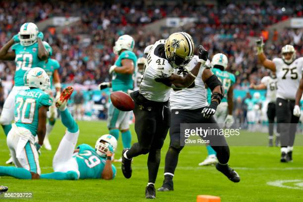 Alvin Kamara of the New Orleans Saints celebrates his touchdown during the NFL match between New Orleans Saints and Miami Dolphins at Wembley Stadium...