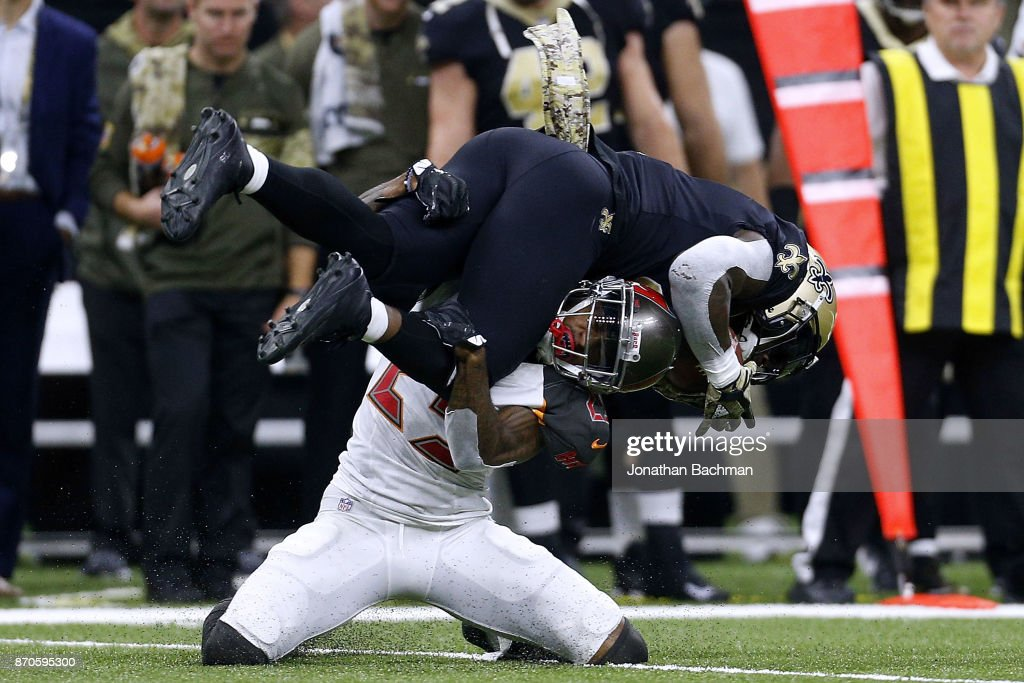 Alvin Kamara #41 of the New Orleans Saints is tackled by Ryan Smith #29 of the Tampa Bay Buccaneers during the first half of a game at Mercedes-Benz Superdome on November 5, 2017 in New Orleans, Louisiana.