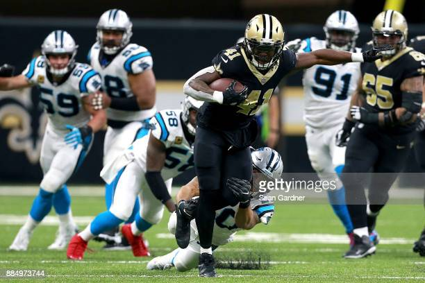 Alvin Kamara of the New Orleans Saints is tackled from behind by Kurt Coleman of the Carolina Panthers during the second half of a NFL game at the...