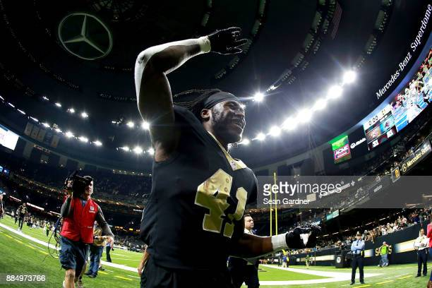 Alvin Kamara of the New Orleans Saints runs off the field after a NFL game against the Carolina Panthers at the MercedesBenz Superdome on December 3...