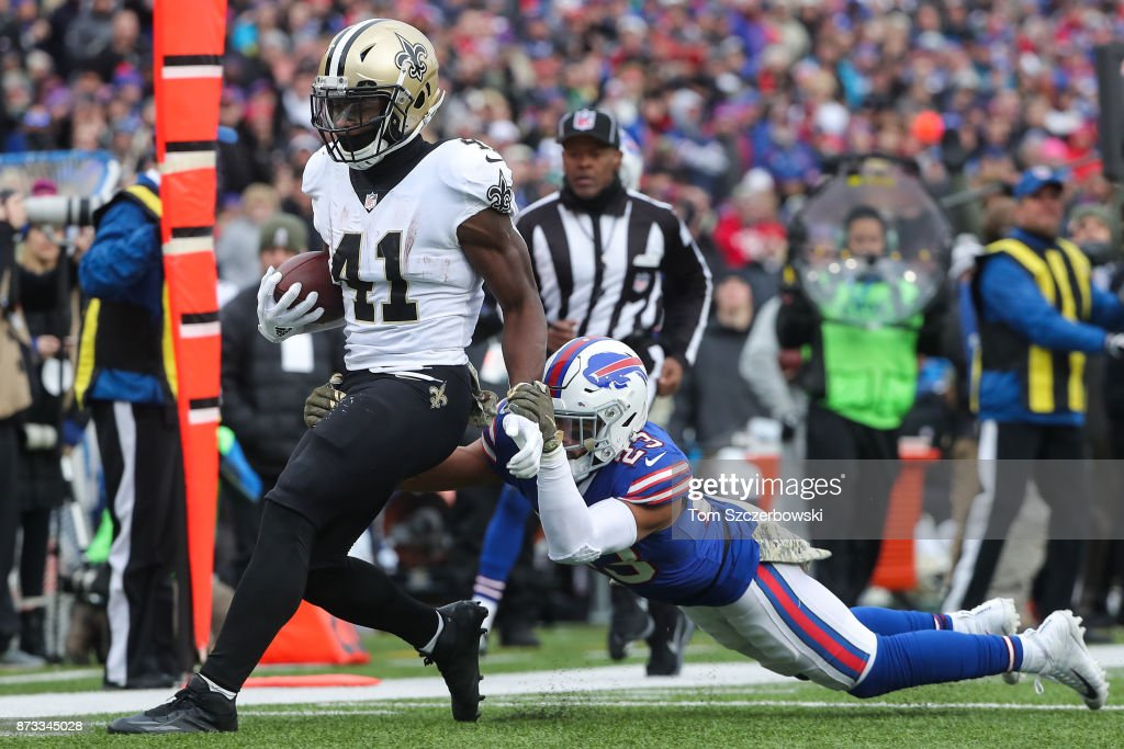 Alvin Kamara #41 of the New Orleans Saints runs the ball as Micah Hyde #23 of the Buffalo Bills attempts to tackle him during the third quarter on November 12, 2017 at New Era Field in Orchard Park, New York.