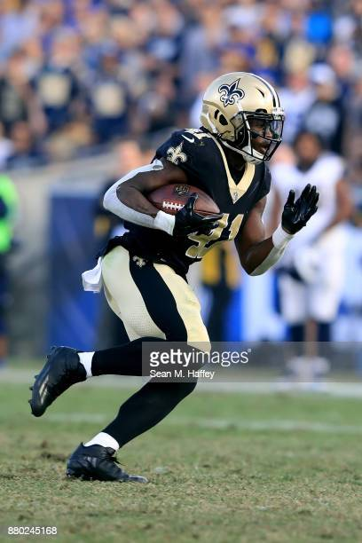 Alvin Kamara of the New Orleans Saints runs the ball during the second half of a game against the New Orleans Saints at Los Angeles Memorial Coliseum...