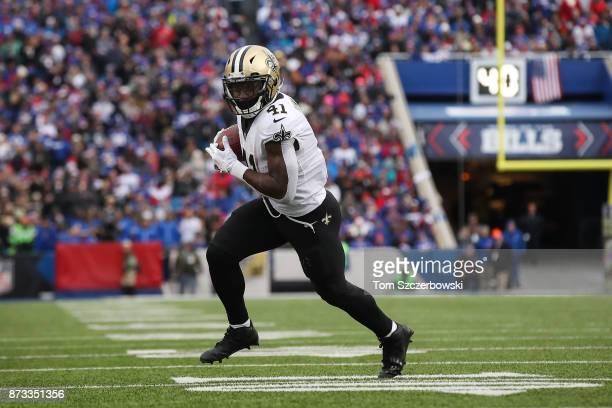 Alvin Kamara of the New Orleans Saints runs the ball during the fourth quarter against the Buffalo Bills on November 12 2017 at New Era Field in...