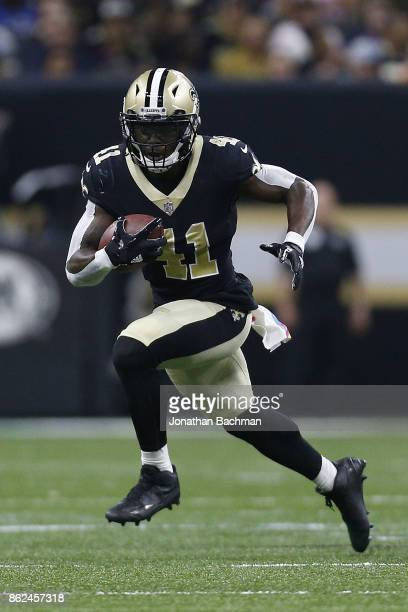 Alvin Kamara of the New Orleans Saints runs with the ball during a game against the Detroit Lions at the MercedesBenz Superdome on October 15 2017 in...