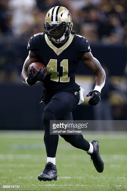 Alvin Kamara of the New Orleans Saints runs with the ball during a game against the Carolina Panthers at the MercedesBenz Superdome on December 3...