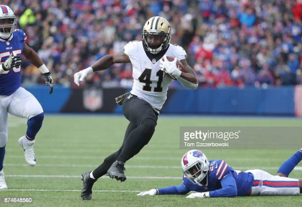 Alvin Kamara of the New Orleans Saints runs with the ball during NFL game action against the Buffalo Bills at New Era Field on November 12 2017 in...