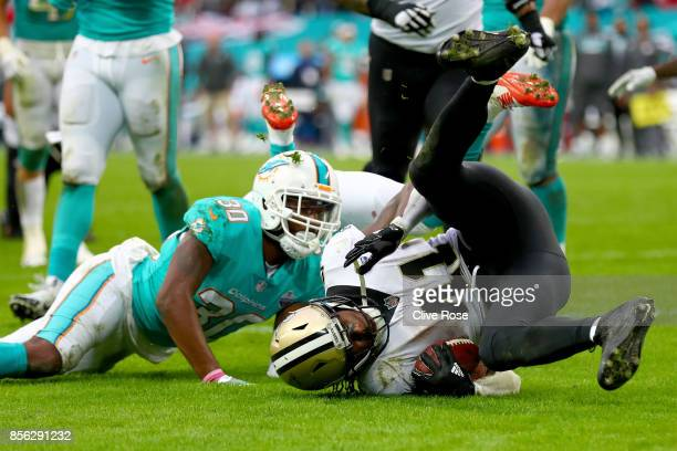 Alvin Kamara of the New Orleans Saints scores a touchdown during the NFL match between New Orleans Saints and Miami Dolphins at Wembley Stadium on...