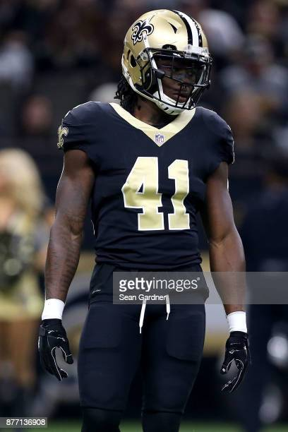 Alvin Kamara of the New Orleans Saints stands on the field during a NFL game against the Washington Redskins at the MercedesBenz Superdome on...