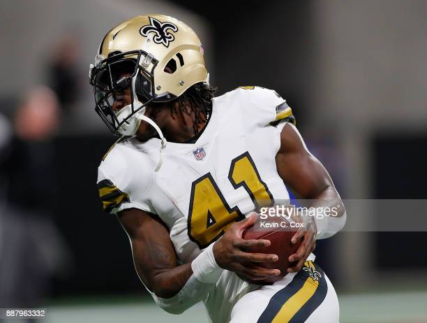 Alvin Kamara of the New Orleans Saints warms up prior to facing the Atlanta Falcons at MercedesBenz Stadium on December 7 2017 in Atlanta Georgia