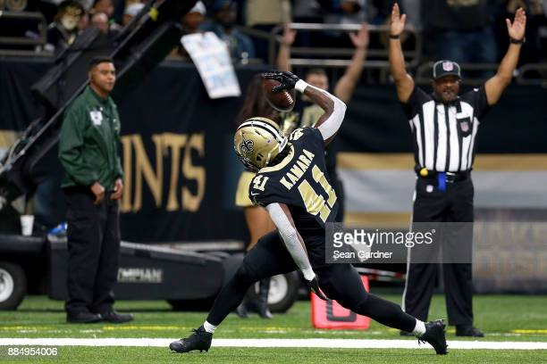 Alvin Kamara spikes the ball after scoring a touchdown against the Carolina Panthers during the first half of a NFL game at the MercedesBenz...