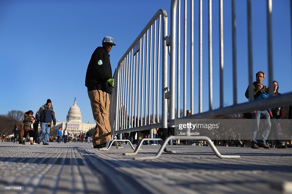 Alvin Martin places barriers in place on the National Mall as preparations continue for the Inauguration ceremony on January 20, 2013 in Washington, DC. The U.S. capital is preparing for the second inauguration of U.S. President Barack Obama, which will take place on January 21.