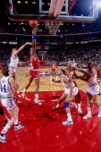 Alvin Robertson of the Western Conference shoots against Kevin McHale of the Eastern Conference during the 1988 NBA AllStar Game on February 7 1988...