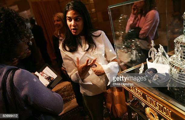Alvina Patel of Harry Winston jewelers explains the history of the Lesotho I one of the world's largest diamonds at The Wedding Salon bridal show...