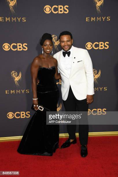 Alvina Stewart and Anthony Anderson arrive for the 69th Emmy Awards at the Microsoft Theatre on September 17 2017 in Los Angeles California / AFP...