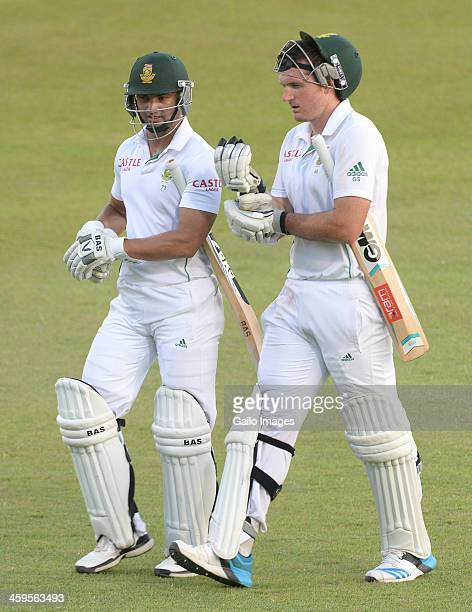 Alviro Petersen and Graeme Smith of South Africa walk off after day 2 of the 2nd Test match between South Africa and India at Sahara Stadium...