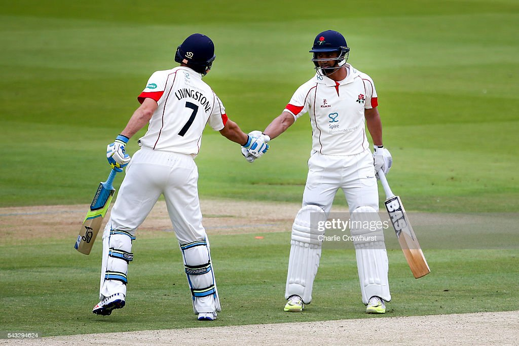 <a gi-track='captionPersonalityLinkClicked' href=/galleries/search?phrase=Alviro+Petersen&family=editorial&specificpeople=4969996 ng-click='$event.stopPropagation()'>Alviro Petersen</a> of Lancashire celebrates his century and a half with team mate Liam Livingstone during day two of the Specsavers County Championship division one match between Midlesex and Lancashire at Lords on June 27, 2016 in London, England.