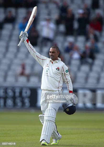 Alviro Petersen of Lancashire celebrates scoring his century during the Specsavers County Championship Division One match between Lancashire and...