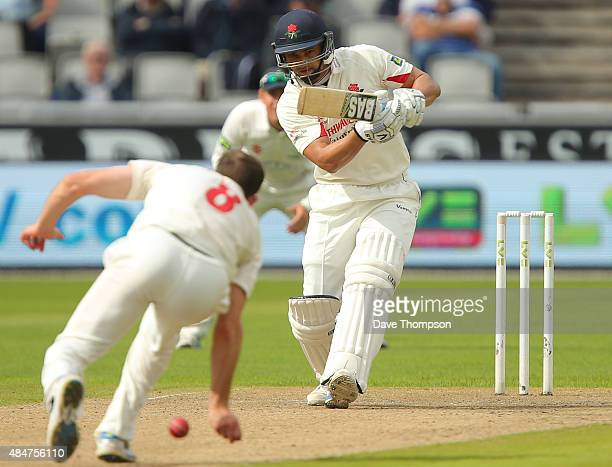 Alviro Petersen of Lancashire plays a shot past Graham Wagg of Glamorgan during the LV County Championship Division Two match between Lancashire and...