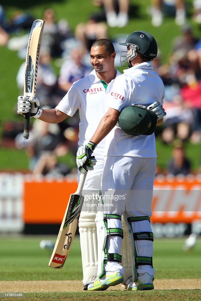 Alviro Petersen (L) of South Africa celebrates his 150 runs while hugging teammate AB de Villiers during day three of the Third Test match between New Zealand and South Africa at Basin Reserve on March 25, 2012 in Wellington, New Zealand.