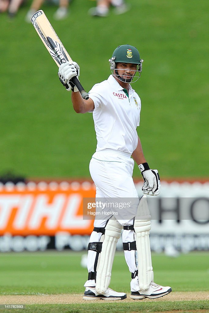 Alviro Petersen of South Africa celebrates his half-century during day two of the Third Test match between New Zealand and South Africa at Basin Reserve on March 24, 2012 in Wellington, New Zealand.