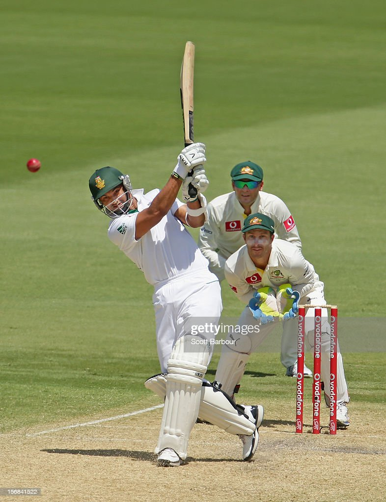 <a gi-track='captionPersonalityLinkClicked' href=/galleries/search?phrase=Alviro+Petersen&family=editorial&specificpeople=4969996 ng-click='$event.stopPropagation()'>Alviro Petersen</a> of South Africa hits a boundary as Michael Clarke and <a gi-track='captionPersonalityLinkClicked' href=/galleries/search?phrase=Matthew+Wade&family=editorial&specificpeople=724041 ng-click='$event.stopPropagation()'>Matthew Wade</a> of Australia look on during day two of the Second Test match between Australia and South Africa at Adelaide Oval on November 23, 2012 in Adelaide, Australia.