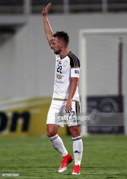 UAE AlWahda FC's Hungarian midfielder Balazs Dzsydzsak reacts after his team's goal against Qatar's AlRayyan SC during their AFC Champions League...