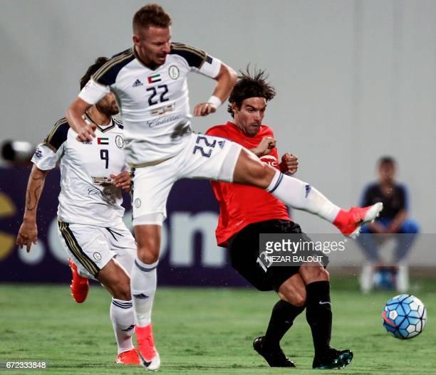 UAE AlWahda FC's Hungarian midfielder Balazs Dzsydzsak vies for the ball against Uruguayan Gonzalo Viera of Qatar's alRayyan SC during their AFC...