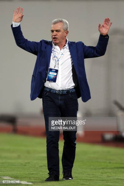 UAE AlWahda FC's Mexican manager Javier Aguirre watches during their AFC Champions League group D football match against Qatar's AlRayyan SC at...