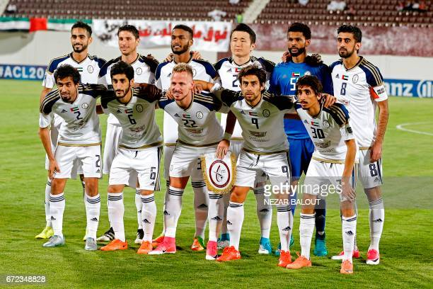 UAE AlWahda FC's players pose for a group picture prior to their AFC Champions League group D football match against Qatar's AlRayyan SC at AlNahyan...